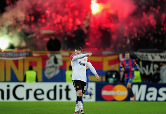 BASEL, SWITZERLAND - DECEMBER 07:  Wayne Rooney of Manchester United walks dejected after Basel scored their second goal during the UEFA Champions League Group C match between FC Basel 1893 and Manchester United at St. Jakob-Park on December 7, 2011 in Ba