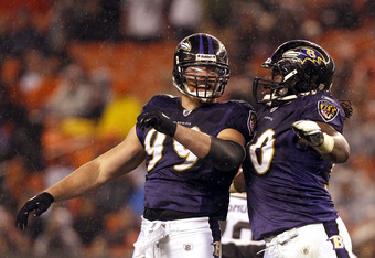 CLEVELAND, OH - DECEMBER 04:  Defenders Parnell McPhee #90 and Paul Kruger #99 of the Baltimore Ravens celebrate after a sack against the Cleveland Browns at Cleveland Browns Stadium on December 4, 2011 in Cleveland, Ohio.  (Photo by Matt Sullivan/Getty I