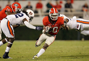 ATHENS, GA - NOVEMBER 12:  Carlton Thomas #30 of the Georgia Bulldogs rushes between T'Sharvan Bell #22 and Eltoro Freeman #21 of the Auburn Tigers at Sanford Stadium on November 12, 2011 in Athens, Georgia.  (Photo by Kevin C. Cox/Getty Images)