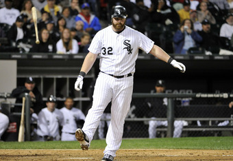 CHICAGO, IL - SEPTEMBER 23:  Adam Dunn #32 of the Chicago White Sox tosses his bat after striking out during the eighth inning against the Kansas City Royals at U. S. Cellular Field on September 24, 2011 in Chicago, Illinois.   (Photo by Brian Kersey/Gett