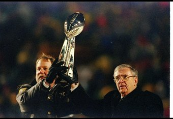 27 Jan 1997: Green Bay Packers head coach Mike Holmgren and Ron Wolf celebrate with the Vince Lombardi Trophy during a post-Super Bowl celebration at Lambeau Field in Green Bay, Wisconsin.