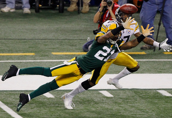 ARLINGTON, TX - FEBRUARY 06:  Charles Woodson #21 of the Green Bay Packers breaks up a pass intended for Mike Wallace #17 of the Pittsburgh Steelers during the second quarter of Super Bowl XLV at Cowboys Stadium on February 6, 2011 in Arlington, Texas.  (