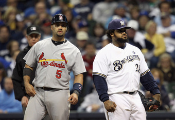 MILWAUKEE, WI - OCTOBER 16:  (L-R) Albert Pujols #5 of the St. Louis Cardinals and Prince Fielder #28 of the Milwaukee Brewers stand on first base after Pujols hit a RBI single in the top of the eighth inning during Game Six of the National League Champio