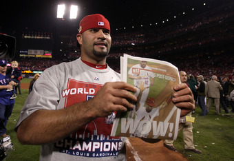 ST LOUIS, MO - OCTOBER 28:  Albert Pujols #5 of the St. Louis Cardinals celebrates after defeating the Texas Rangers 6-2 to win the World Series in Game Seven of the MLB World Series at Busch Stadium on October 28, 2011 in St Louis, Missouri.  (Photo by E