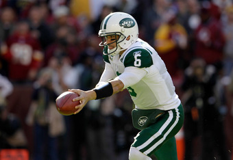 LANDOVER, MD - DECEMBER 04:  Mark Sanchez #6 of the New York Jets prepares to hand the ball off against the Washington Redskins at FedExField on December 4, 2011 in Landover, Maryland.  (Photo by Rob Carr/Getty Images)