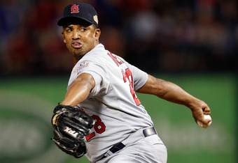 ARLINGTON, TX - OCTOBER 24:  Octavio Dotel #28 of the St. Louis Cardinals pitches in the eighth inning during Game Five of the MLB World Series against the St. Louis Cardinals at Rangers Ballpark in Arlington on October 24, 2011 in Arlington, Texas.  (Pho