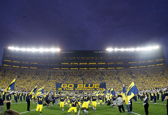 ANN ARBOR, MI - SEPTEMBER 10: The Michigan Wolverines take the field for the first night game ever at Michigan Stadium to play the Notre Dame Fighting Irish on September 10, 2010 in Ann Arbor, Michigan. (Photo by Gregory Shamus/Getty Images)