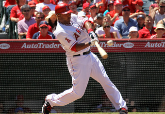 ANAHEIM, CA - AUGUST 7: Vernon Wells #10 of the Los Angeles Angels of Anaheim hits an RBI single in  the seventh inning against the Seattle Mariners on August 7, 2011 at Angel Stadium in Anaheim, California.  The Angels won 2-1.  (Photo by Stephen Dunn/Ge