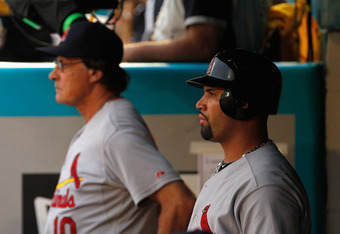 MIAMI GARDENS, FL - AUGUST 06:  Albert Pujols #5 and Manager and Tony La Russa #10 of the St. Louis Cardinals look on during a game against the Florida Marlins at Sun Life Stadium on August 6, 2011 in Miami Gardens, Florida.  (Photo by Mike Ehrmann/Getty