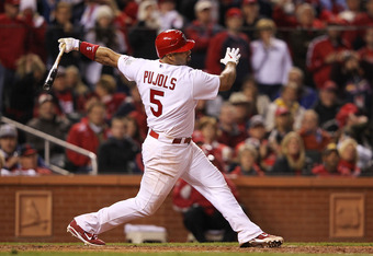 ST LOUIS, MO - OCTOBER 28:  Albert Pujols #5 of the St. Louis Cardinals strikes out in the seventh inning during Game Seven of the MLB World Series against the Texas Rangers at Busch Stadium on October 28, 2011 in St Louis, Missouri.  (Photo by Jamie Squi