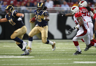 ST. LOUIS, MO - NOVEMBER 27: Steven Jackson #39 of the St. Louis Rams runs against the Arizona Cardinals at the Edward Jones Dome on November 27, 2011 in St. Louis, Missouri.  (Photo by Dilip Vishwanat/Getty Images)