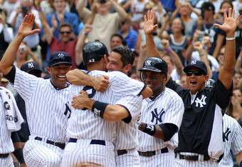NEW YORK, NY - JULY 09:  Derek Jeter #2 of the New York Yankees celebrates at home with teammates Jorge Posada #20, Mariano Rivera #42, Alex Rodriguez #13 and Curtis Granderson #14 after hitting a solo home run in the third inning for career hit 3000 whil