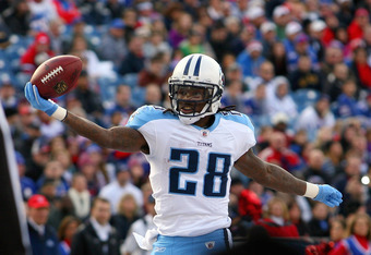 ORCHARD PARK, NY - DECEMBER 04:  Chris Johnson #28 of the Tennessee Titans scores his second touchdown of the game in the first half against the Buffalo Bills at Ralph Wilson Stadium on December 4, 2011 in Orchard Park, New York.  (Photo by Rick Stewart/G