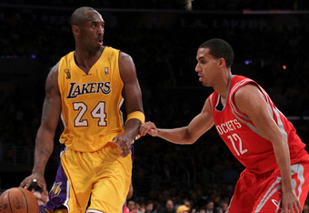 LOS ANGELES, CA - OCTOBER 26:  Kobe Bryant #24 of the Los Angeles Lakers drives with the ball against Kevin Martin #12 of the Houston Rockets during their opening night game at Staples Center on October 26, 2010 in Los Angeles, California. NOTE TO USER: U