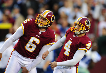 LANDOVER, MD - NOVEMBER 20: Graham Gano #4 and Sav Rocca #6 of the Washington Redskins watch as a field goal attempt by Gano misses in overtime against the Dallas Cowboys at FedEx Field on November 20, 2011 in Landover, Maryland. (Photo by Scott Cunningha