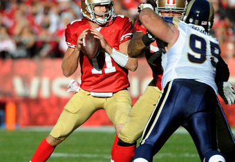 SAN FRANCISCO, CA - DECEMBER 04: Alex Smith of the San Francisco 49ers drops back to pass against the St Louis Rams at Candlestick Park on December 4, 2011 in San Francisco, California.  (Photo by Thearon W. Henderson/Getty Images)