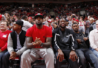 LeBron enjoying his time off with Dwyane Wade and friends at a recent Ohio State Basketball game.
