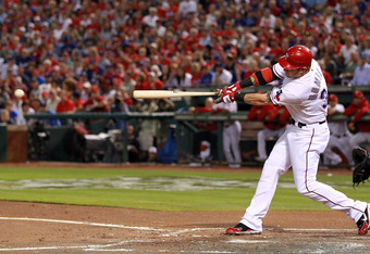 ARLINGTON, TX - OCTOBER 23:  Josh Hamilton #32 of the Texas Rangers hits an RBI double in the first inning during Game Four of the MLB World Series against the St. Louis Cardinals at Rangers Ballpark in Arlington on October 23, 2011 in Arlington, Texas.