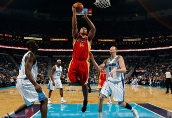 NEW ORLEANS, LA - JANUARY 02:  Chuck Hayes #44  of the Houston Rockets makes a shot over Darius Songaila #9 and Emeka Okafor #50 of the New Orleans Hornets at the New Orleans Arena on January 2, 2010 in New Orleans, Louisiana.  NOTE TO USER: User expressl