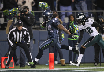 SEATTLE - DECEMBER 01:  Running back Marshawn Lynch #24 of the Seattle Seahawks rushes for a touchdown against Asante Samuel #22 of the Philadelphia Eagles at CenturyLink Field on December 1, 2011 in Seattle, Washington. (Photo by Otto Greule Jr/Getty Ima