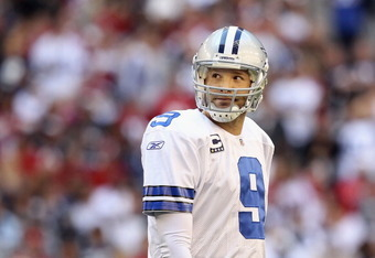 GLENDALE, AZ - DECEMBER 04:  Quarterback Tony Romo #9 of the Dallas Cowboys looks up as he walks off the field during the NFL game against the Arizona Cardinals at the University of Phoenix Stadium on December 4, 2011 in Glendale, Arizona. The Cardinals d