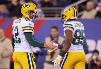 EAST RUTHERFORD, NJ - DECEMBER 04:  (L-R) Aaron Rodgers #12 and Greg Jennings #85 of the Green Bay Packers celebrate after Jennings caught a 20-yard touchdwon pass from Rodgers in the third quarter against the New York Giants at MetLife Stadium on Decembe