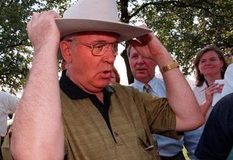 From this picture it seems that Mikhail Gorbachev just might be an Oklahoma State Cowboy fan.