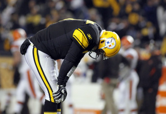 PITTSBURGH, PA - DECEMBER 8:   Ben Roethlisberger #7 of the Pittsburgh Steelers reacts after throwing a touchdown pass to  Antonio Brown #84 (not pictured) during the game on December 8, 2011 at Heinz Field in Pittsburgh, Pennsylvania.  The Steelers won 1