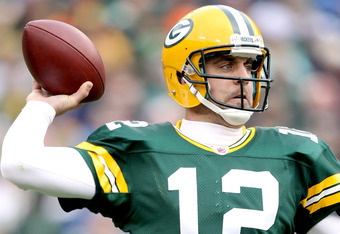 GREEN BAY, WI - NOVEMBER 20:  Aaron Rodgers #12 of the Green Bay Packers throws against the Tampa Bay Buccaneers at Lambeau Field on November 20, 2011 in Green Bay, Wisconsin.  (Photo by Matthew Stockman/Getty Images)