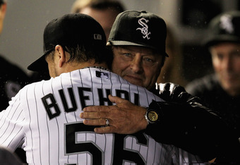 CHICAGO, IL - SEPTEMBER 27:  Starting pitcher Mark Buehrle #56 of the Chicago White Sox gets a hug from interim manager and pitching coach Don Cooper after being taken out of a game against the Toronto Blue Jays at U.S. Cellular Field on September 27, 201