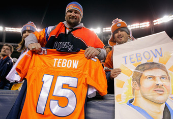 DENVER, CO - NOVEMBER 17:  Fans show their support of quarterback Tim Tebow #15 of the Denver Broncos as the Broncos defeated the Jets 17-13 at Sports Authority Field at Mile High on November 17, 2011 in Denver, Colorado.  (Photo by Doug Pensinger/Getty I