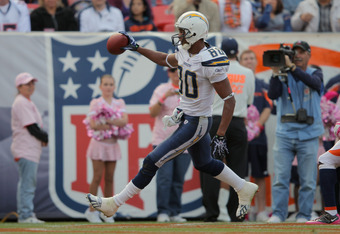 DENVER, CO - OCTOBER 09:  Wide receiver Malcom Floyd #80 of the San Diego Chargers celebrates his 42 yard touchdown reception in the second quarter against the Denver Broncos at Sports Authority Field at Mile High on October 9, 2011 in Denver, Colorado. T