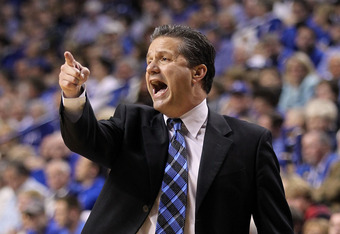 LEXINGTON, KY - DECEMBER 01:  John Calipari the head coach of the Kentucky Wildcats gives instructions to his team during the game against the St.John's Red Storm at Rupp Arena on December 1, 2011 in Lexington, Kentucky.  (Photo by Andy Lyons/Getty Images