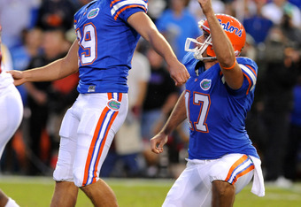 GAINESVILLE, FL - OCTOBER 17: Kicker Caleb Sturgis #19 and holder Chas Henry #17 of the Florida Gators follow a game-winning 27-yard field goal against the University of Arkansas Razorbacks October 17, 2009 at Ben Hill Griffin Stadium in Gainesville, Flor