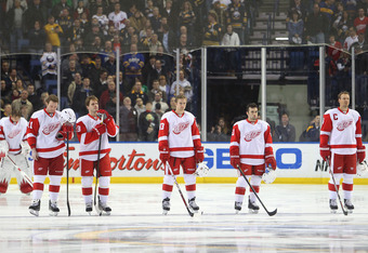 BUFFALO, NY - DECEMBER 2: Jimmy Howard #35 Danny Cleary #11 Ian White #18  Darren Helm #43 Chris Conner #41 and Nicklas Lidstrom #5 of the Detroit Red Wings stand for the playing of the anthem before their NHL game against the Buffalo Sabres at First Niag