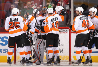 GLENDALE, AZ - DECEMBER 03:  Goaltender Ilya Bryzgalov #30 of the Philadelphia Flyers is congratulated by Brayden Schenn #10 after defeating the Phoenix Coyotes in the NHL game at Jobing.com Arena on December 3, 2011 in Glendale, Arizona. The Flyers defea