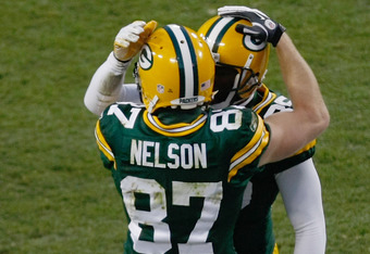 GREEN BAY, WI - DECEMBER 11: Jordy Nelson #87 of the Green Bay Packers celebrates a touchdown with Donald Driver #80 during the game against the Oakland Raiders at Lambeau Field on December 11, 2011 in Green Bay, Wisconsin. (Photo by Scott Boehm/Getty Ima