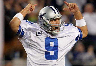 ARLINGTON, TX - DECEMBER 11:  Tony Romo #9 of the Dallas Cowboys celebrates after the Cowboys scored against the New York Giants in the fourth quarter at Cowboys Stadium on December 11, 2011 in Arlington, Texas.  (Photo by Tom Pennington/Getty Images)