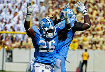 ATLANTA - SEPTEMBER 24: Giovani Bernard #26 of the North Carolina Tar Heels celebrates with Ryan Houston #32 after scoring against the Georgia Tech Yellow Jackets at Bobby Dodd Field on September 24, 2011 in Atlanta, Georgia. Photo by Scott Cunningham/Get