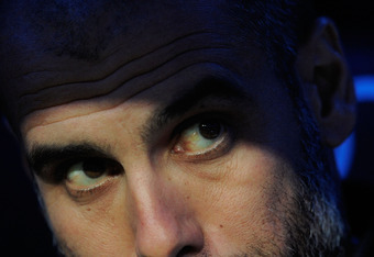 MADRID, SPAIN - DECEMBER : Barcelona head coach Josep Guardiola looks out from the dugout before the La Liga match between Real Madrid and Barcelona at Estadio Santiago Bernabeu on December 10, 2011 in Madrid, Spain.  (Photo by Denis Doyle/Getty Images)