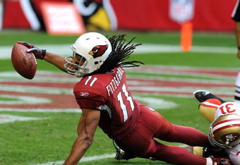 Cardinals wide receiver Larry Fitzgerald caps a 46-yard pass from John Skelton with Arizona's second touchdown of the game.  Fitzgerald totaled 149 receiving yards on the day.