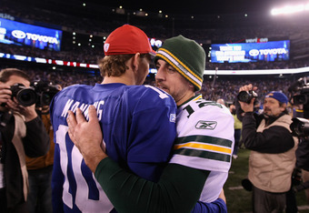 EAST RUTHERFORD, NJ - DECEMBER 04:  (L-R) Eli Manning #10 of the New York Giants congratulates Aaron Rodgers #12 of the Green Bay Packers after the Packers won 38-35 at MetLife Stadium on December 4, 2011 in East Rutherford, New Jersey.  (Photo by Al Bell