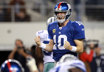 ARLINGTON, TX - DECEMBER 11:  Eli Manning #10 of the New York Giants celebrates the game winning touchdown against the Dallas Cowboys in the fourth quarter at Cowboys Stadium on December 11, 2011 in Arlington, Texas.  (Photo by Ronald Martinez/Getty Image