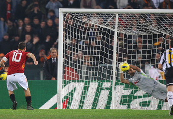 ROME, ITALY - DECEMBER 12:  Goalkeeper Gianluigi Buffon of Juventus saves a penalty kick by Francesco Totti of AS Roma (L) during the Serie A match between AS Roma and Juventus FC at Stadio Olimpico on December 12, 2011 in Rome, Italy.  (Photo by Paolo Br