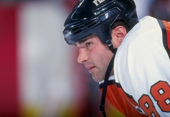 4 Dec 1998: Eric Lindros #88 of the Philadelphia Flyers waits on the ice during the game against the Buffalo Sabres at the Marine Midland Arena in Buffalo, New York. The Sabres defeated the Flyers 3-1. Mandatory Credit: Rick Stewart  /Allsport