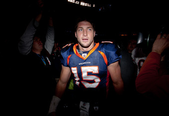 DENVER, CO - DECEMBER 11:  Quarterback Tim Tebow #15 of the Denver Broncos walks off the field after winning in overtime against the Chicago Bears at Sports Authority Field at Mile High on December 11, 2011 in Denver, Colorado. The Broncos defeated the Be