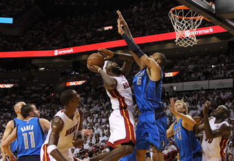 MIAMI, FL - JUNE 12:  LeBron James #6 of the Miami Heat drives for a shot attempt against Tyson Chandler #6 of the Dallas Mavericks in Game Six of the 2011 NBA Finals at American Airlines Arena on June 12, 2011 in Miami, Florida. NOTE TO USER: User expres
