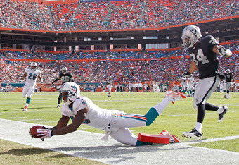 MIAMI GARDENS, FL - DECEMBER 04:  Brandon Marshall #19 of the Miami Dolphins attempts a catch during a game against the Oakland Raiders  at Sun Life Stadium on December 4, 2011 in Miami Gardens, Florida.  (Photo by Mike Ehrmann/Getty Images)