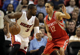 MIAMI, FL - MARCH 27: Guard Dwyane Wade of the Miami Heat drives against gurad Kevin Martin #12 of the Houston Rockets  at American Airlines Arena on March 27, 2011 in Miami, Florida. NOTE TO USER: User expressly acknowledges and agrees that, by downloadi