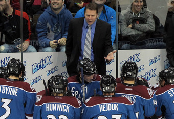 DENVER, CO - NOVEMBER 23:  Head coach Joe Sacco of the Colorado Avalanche directs the team during a time out against the Vancouver Canucks at the Pepsi Center on November 23, 2011 in Denver, Colorado. The Canucks defeated the Avalanche 3-0.  (Photo by Dou